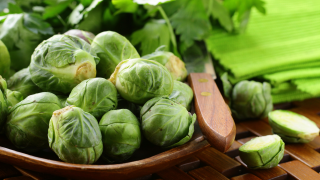 fresh raw brussels sprouts on a wooden table and knife