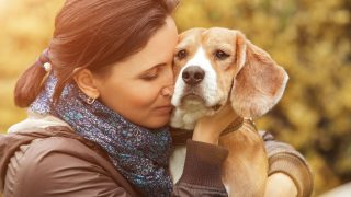 Woman and her favorite dog portrait hugging outdoors