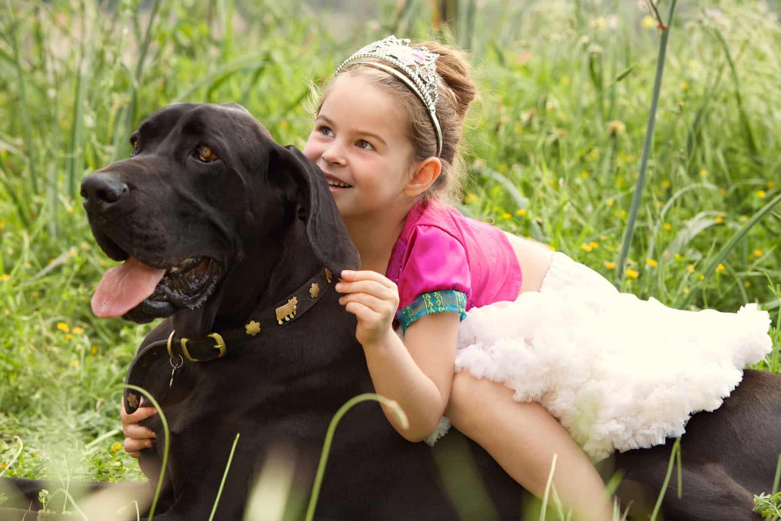 beautiful young girl wearing a fancy dress, sitting on her dog pet back