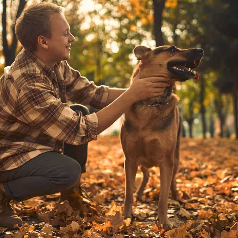 james davis with his dog in nature